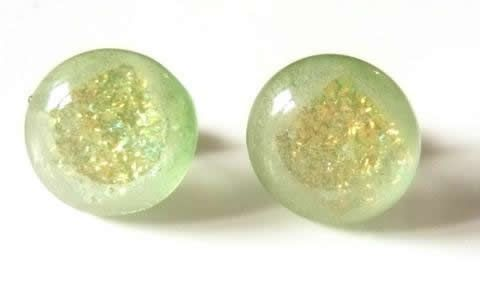 Pretty pale green with interior golden sparkle, these are lovely dichroic studs.